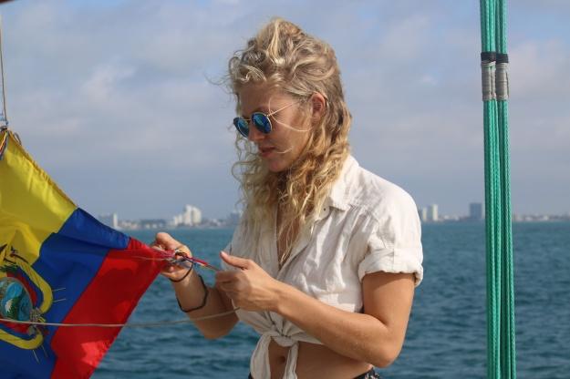 Kim is hoisting the Ecuadorian flag